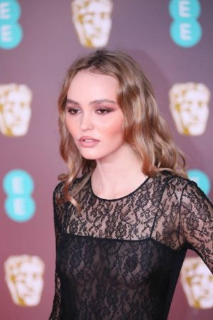 Lily Rose Depp Braless in a Black Lace Gown on the Red Carpet