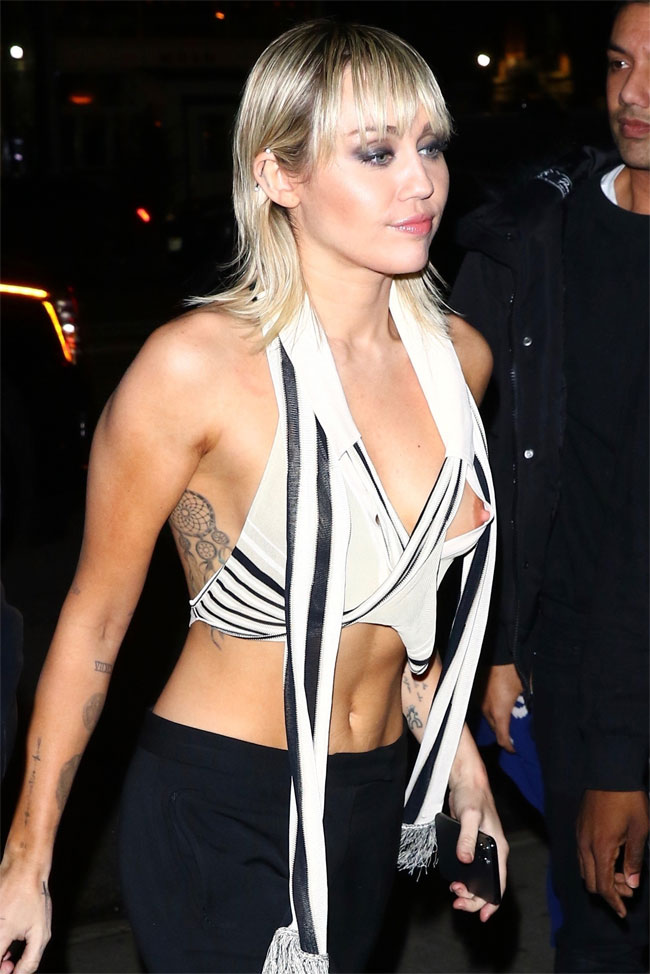 Miley Cyrus Has a Nipple Exposed in White Vest