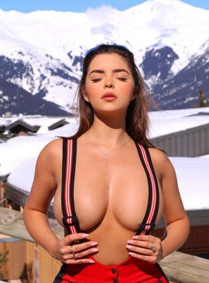 Demi Rose Topless with her Nipples Covered by Suspenders
