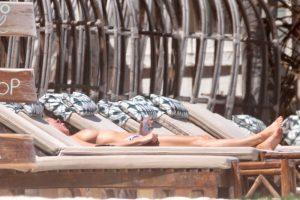 Kristen Hancher Caught Topless on a Beach