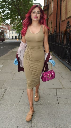 Carla Howe Braless in a Super Tight Dress While Shopping