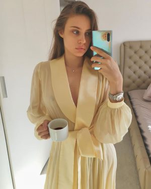 Xenia Tchoumitcheva in a Slightly See Through Yellow Robe