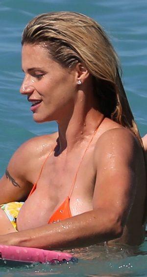 Michelle Hunziker Nipple Slip from her Bikini Top in the Ocean