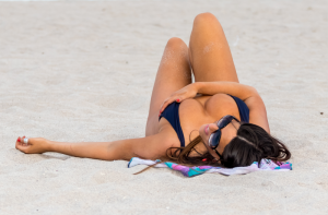 Claudia Romani Nipple Pops Out While Lying on the Sand
