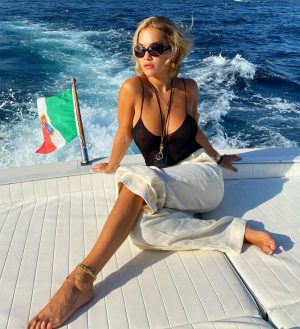 Rita Ora Braless in Black Top on the Back of a Boat