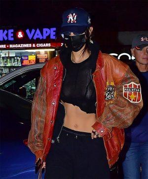 Bella Hadid Braless in Black Top & Leather Jacket